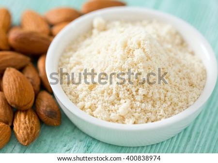 almond flour on wooden surface - stock photo