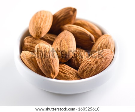 Almond. Heap of nuts isolated on white background. Selective focus - stock photo