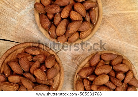 almond in dish on wooden table