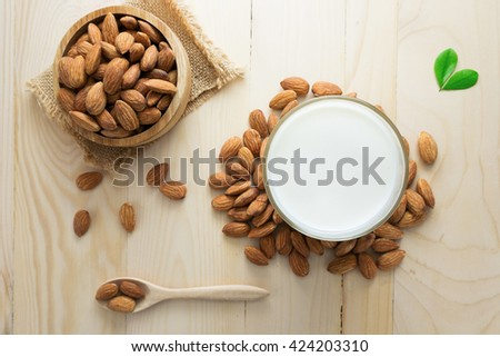 Almond milk in a glass with almonds. - stock photo