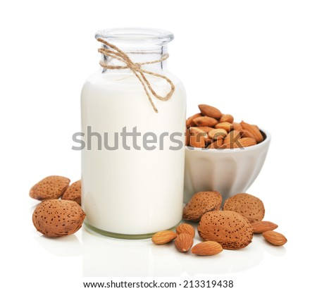 Almond milk in bottle with nuts isolated on white background - stock photo
