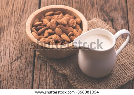 Almond milk in glass with almonds.vintage process style - stock photo