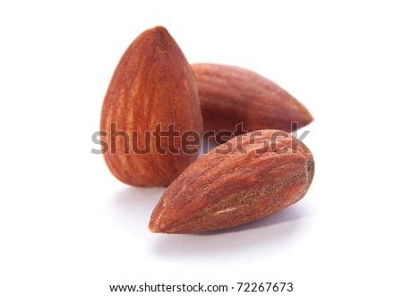 Almond nut fruit closeup on white background - stock photo