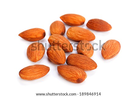 Almond nut seed closeup isolated on white - stock photo