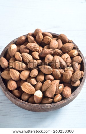 Almond nuts in the wooden bowl,selective focus   - stock photo