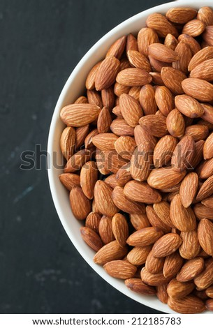 almond nuts in white bowl.