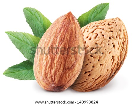 Almond nuts with leaves. Isolated on a white background. Clipping path. - stock photo