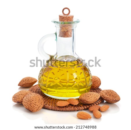 Almond oil in bottle isolated on white background - stock photo