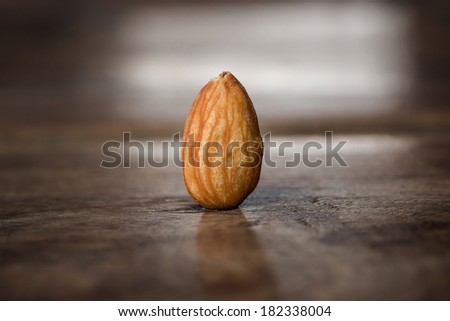 Almond on wooden table - stock photo