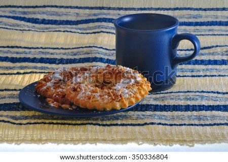 almond shortbread cookies with blue saucer and cup - stock photo