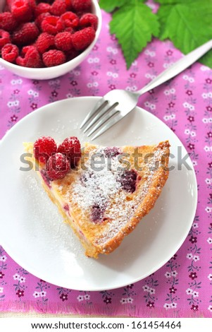 Almond tart with raspberries and white chocolate