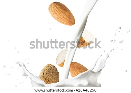 Almond With Milk Splash - stock photo