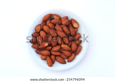 almond with salt in the white plate - stock photo