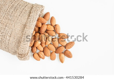 almonds, almonds in sack on over white background, top view