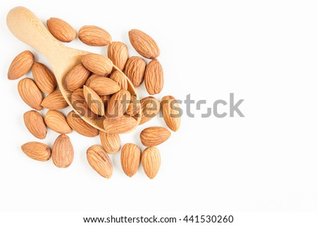almonds, almonds on wooden spoon isolated over white background, top view