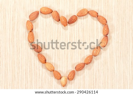 Almonds are laid out in the shape of a heart on the dining table