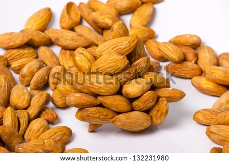 almonds close-up as background.
