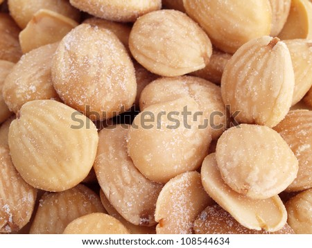 Almonds. Close up of fried, peeled and salted  almonds. - stock photo