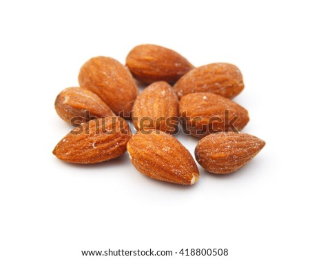 Almonds close up on the white - stock photo