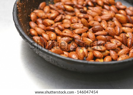 almonds fried in a pan with olive oil