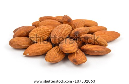 almonds in heap over white background