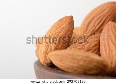 Almonds in the foreground  - stock photo
