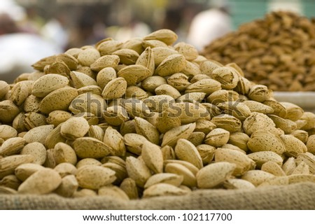 Almonds in their shells at a market in Delhi, India - stock photo