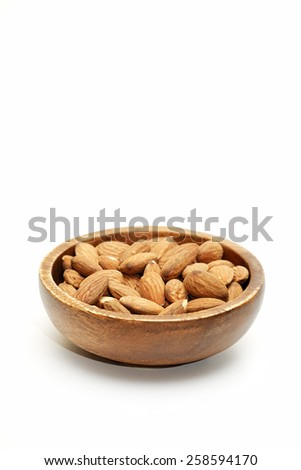 Almonds in wooden bowls on white background - stock photo