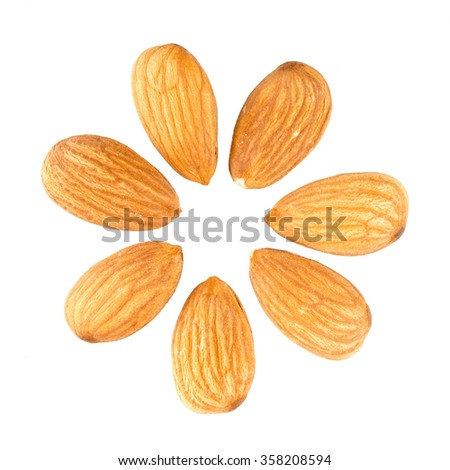 Almonds laid out in a circle in the shape of flower petals