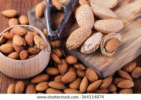 almonds nuts on a wooden table - stock photo