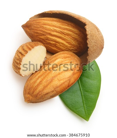 Almonds nuts with leaf isolated on white background. - stock photo