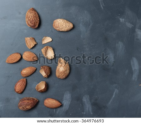 Almonds on a black slate background,top view