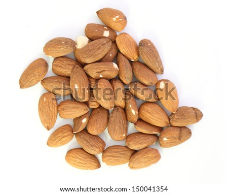 Almonds on a white background close-up - stock photo