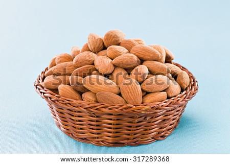 Almonds on blue background. - stock photo