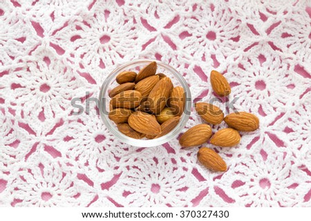 almonds on pink tablecloth nuts useful products - stock photo