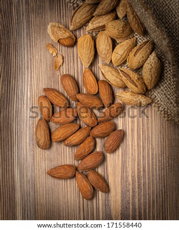Almonds on rustic wooden background