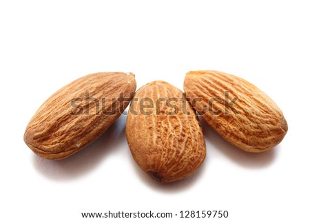 almonds over white background