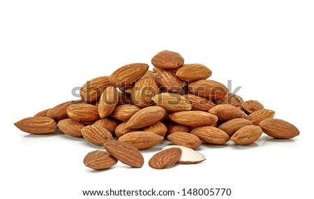Almonds pile on white background - stock photo