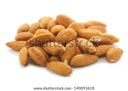 Almonds seeds on white background.