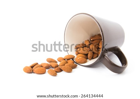 Almonds spilling on white background - stock photo
