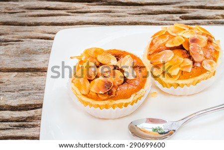 Almonds tart on wooden table background.(for coffee break) - stock photo