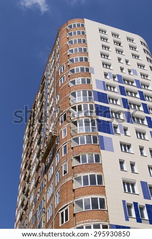 Almost complete multiroom house in the sunny clear afternoon - stock photo