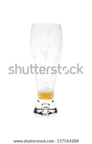 Almost Empty Beer Glass - stock photo
