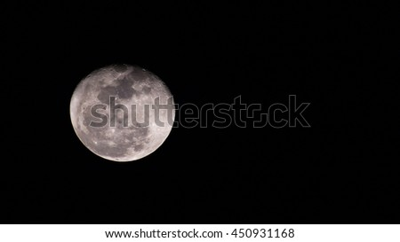 Almost full moon (gibbous moon) with space for text on the right