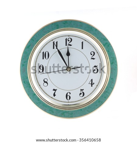 Almost twelve o'clock on big wall clock isolated on white closeup - stock photo