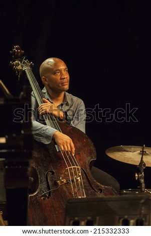 ALMUNECAR, GRANADA / SPAIN - JULY 21, 2014: Joshua Redman Quartet playing live music, at XXVII international jazz festival of Almunecar, Jazz in the Cost. Reuben Rogers, bass.