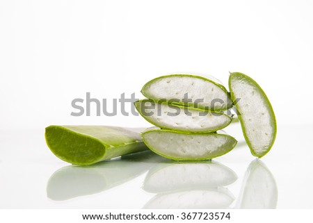 Aloe sliced, isolated on a reflect white background