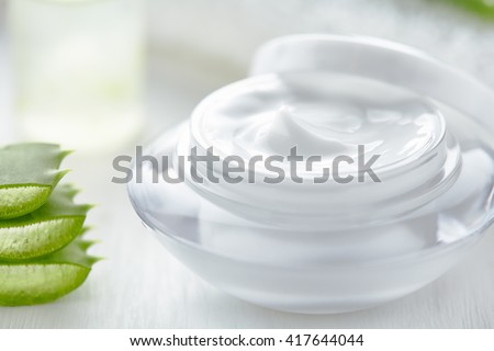 Aloe vera cosmetic anti wrinkle cream skin face and body care hygiene moisture lotion wellness dermatology medicine therapy mask treatment in product container on white background - stock photo