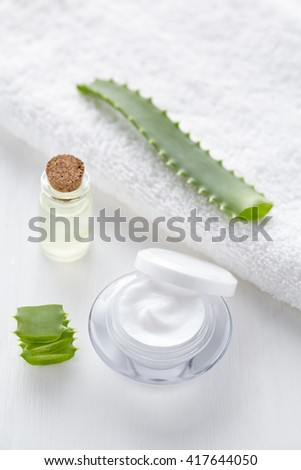 Aloe vera cosmetic cream skin face and body care hygiene moisture lotion wellness natural healthy dermatology medicine anti wrinkle therapy mask treatment in product container on white background - stock photo