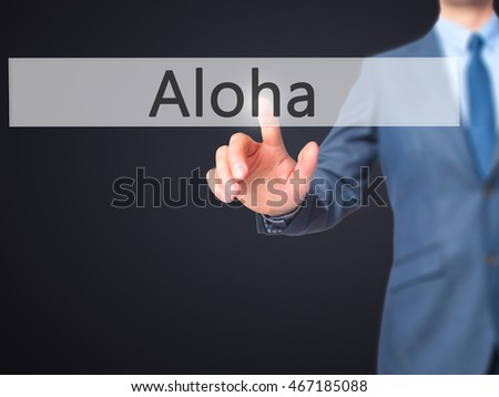 Aloha - Businessman press on digital screen. Business,  internet concept. Stock Photo